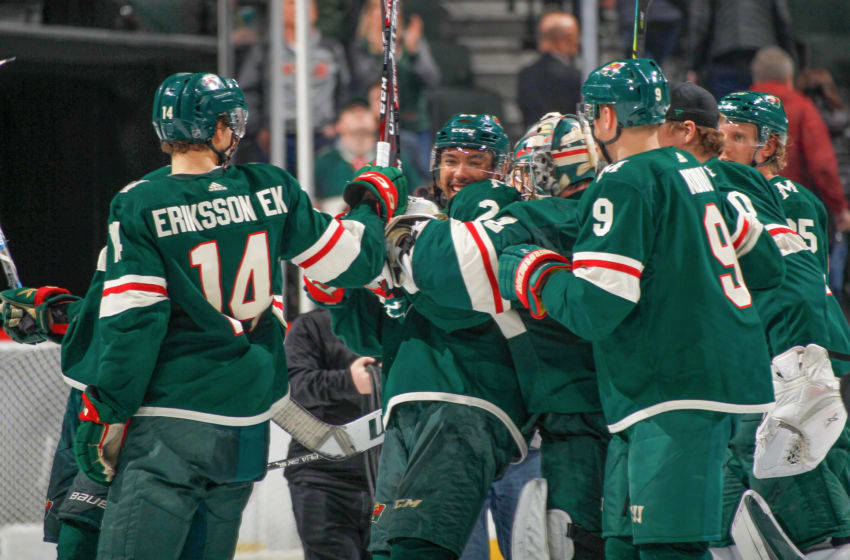 SAINT PAUL, MN - FEBRUARY 4: Matt Dumba #24 of the Minnesota Wild celebrates with his teammates after scoring the game winning goal in overtime against the Chicago Blackhawks at the Xcel Energy Center on February 4, 2020 in Saint Paul, Minnesota. (Photo by Bruce Kluckhohn/NHLI via Getty Images)