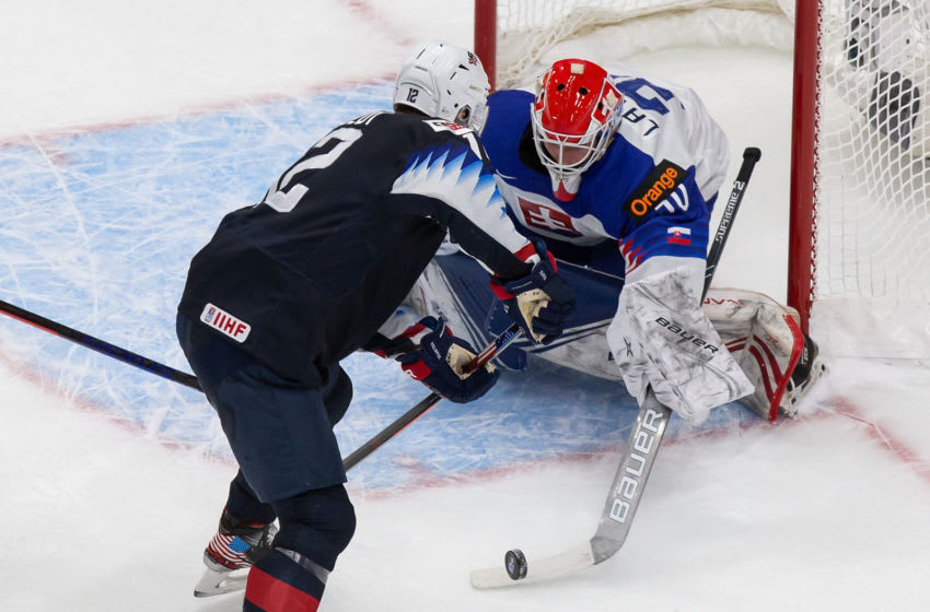 EDMONTON, AB - JANUARY 02: Matthew Boldy #12 of the United States skates against goaltender Simon Latkoczy #30 of Slovakia during the 2021 IIHF World Junior Championship quarterfinals at Rogers Place on January 2, 2021 in Edmonton, Canada. (Photo by Codie McLachlan/Getty Images)