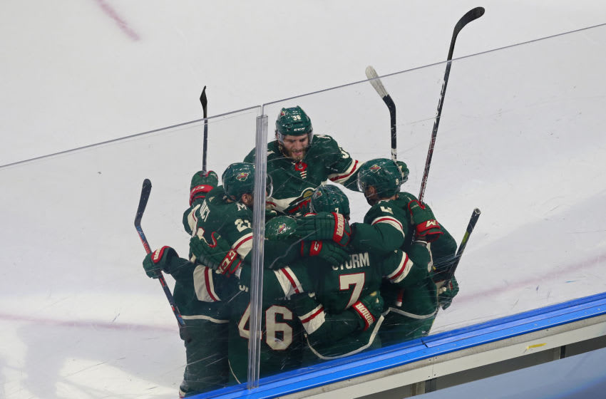 EDMONTON, ALBERTA - AUGUST 07: Nico Sturm #7 of the Minnesota Wild is congratulated by his teammates after scoring a goal against the Vancouver Canucks during the second period in Game Four of the Western Conference Qualification Round prior to the 2020 NHL Stanley Cup Playoffs at Rogers Place on August 07, 2020 in Edmonton, Alberta. (Photo by Jeff Vinnick/Getty Images)