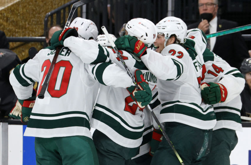 Members of the Minnesota Wild celebrat a goal by Zach Parise during the first period Friday. The Wild fell to Vegas in Game 7 after rallying from a 3-1 series deficit. (Photo by Ethan Miller/Getty Images)