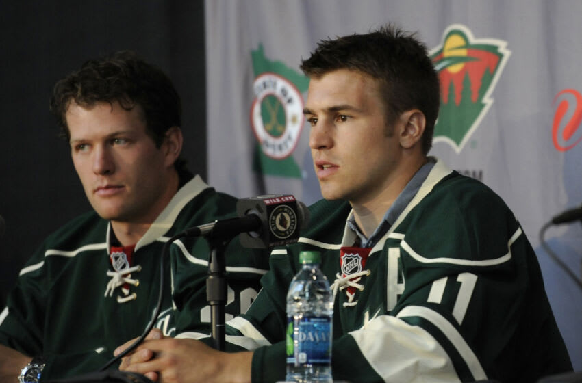Ryan Suter, left, and Zach Parise, both signed massive contracts with the Minnesota Wild in 2012. Their buyouts will come with a price for the Wild in the future as well. (Photo by Hannah Foslien/Getty Images)