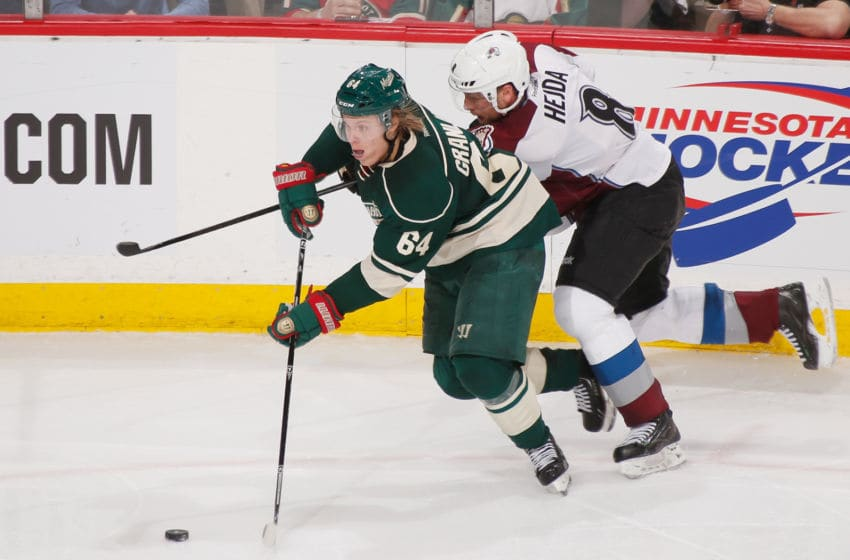 ST. PAUL, MN - APRIL 21: Mikael Granlund #64 of the Minnesota Wild skates chased by Jan Hejda #8 of the Colorado Avalanche during Game Three of the First Round of the 2014 Stanley Cup Playoffs on April 21, 2014 at the Xcel Energy Center in St. Paul, Minnesota. (Photo by Bruce Kluckhohn/NHLI via Getty Images)