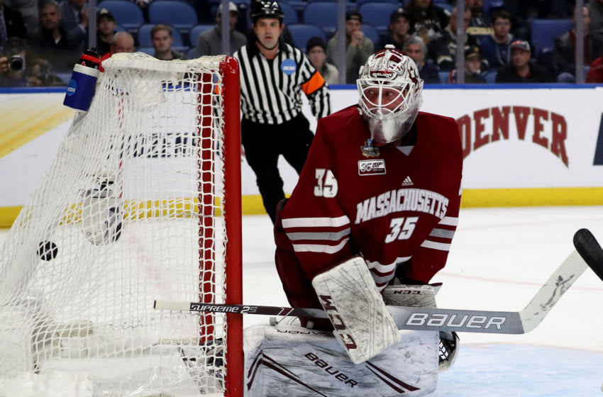 BUFFALO, NEW YORK - APRIL 13: Filip Lindberg #35 of the Massachusetts Minutemen watches a shot by Parker Mackay of the Minnesota-Duluth Bulldogs fly past in the first period during the 2019 NCAA Frozen Four the championship game at KeyBank Center on April 13, 2019 in Buffalo, New York. (Photo by Elsa/Getty Images)