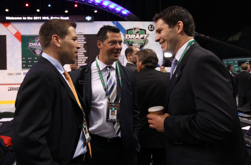 ST PAUL, MN - JUNE 24: Doug Weight of the New York Islanders, Bill Guerin of the Pittsburgh Penguins and Scott Lachance of the New Jersey Devils look on during day one of the 2011 NHL Entry Draft at Xcel Energy Center on June 24, 2011 in St Paul, Minnesota. (Photo by Bruce Bennett/Getty Images)