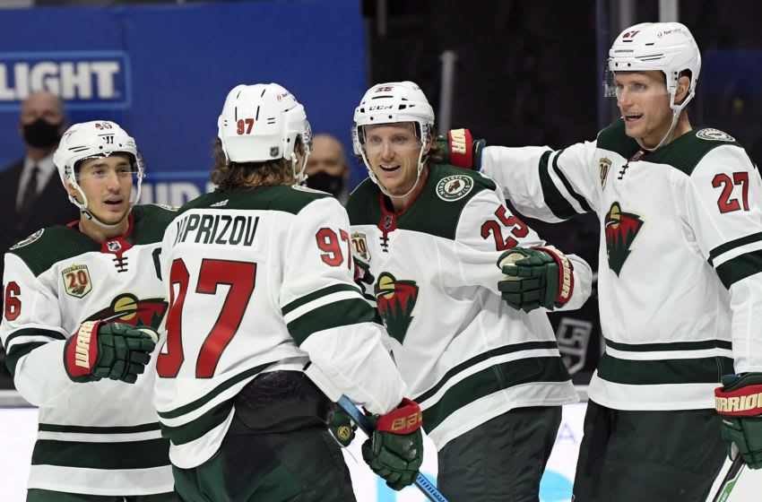 LOS ANGELES, CALIFORNIA - JANUARY 14: Jonas Brodin #25 of the Minnesota Wild celebrates his goal with Jared Spurgeon #46, Kirill Kaprizov #97 and Nick Bjugstad #27 of the Minnesota Wild, to take a 1-0 lead, during the first period in the season opening game at Staples Center on January 14, 2021 in Los Angeles, California. (Photo by Harry How/Getty Images)