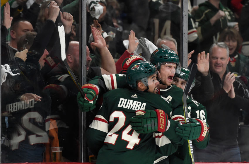 ST PAUL, MN - APRIL 15: (L-R) Matt Dumba #24, Eric Staal #12 and Jason Zucker #16 of the Minnesota Wild celebrate a goal against the Winnipeg Jets by Staal during the second period in Game Three of the Western Conference First Round during the 2018 NHL Stanley Cup Playoffs at Xcel Energy Center on April 15, 2018 in St Paul, Minnesota. The Wild defeated the Jets 6-2. (Photo by Hannah Foslien/Getty Images)