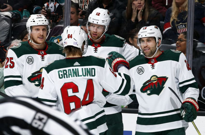 ANAHEIM, CA - NOVEMBER 9: Jonas Brodin #25, Eric Staal #12, Jordan Greenway #18, and Mikael Granlund #64 of the Minnesota Wild celebrate a second period goal during the game against the Anaheim Ducks on November 9, 2018 at Honda Center in Anaheim, California. (Photo by Debora Robinson/NHLI via Getty Images)
