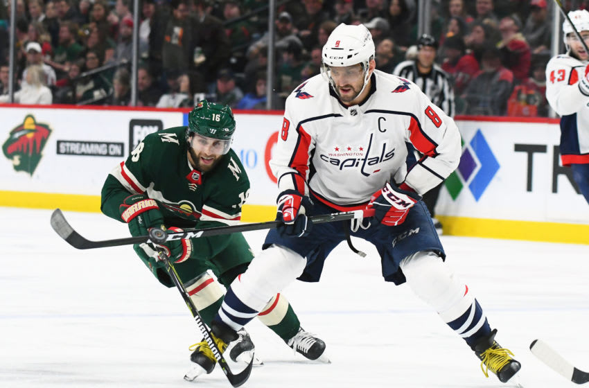 ST. PAUL, MN - FEBRUARY 15: Minnesota Wild Left Wing Jason Zucker (16) and Washington Capitals Left Wing Alex Ovechkin (8) battle for a loose puck during a NHL game between the Minnesota Wild and Washington Capitals on February 15, 2018 at Xcel Energy Center in St. Paul, MN. The Capitals defeated the Wild 5-2. (Photo by Nick Wosika/Icon Sportswire via Getty Images)