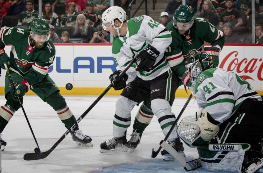 St. Paul, MN-September 17: Jason Zucker (16) of the Minnesota Wild and Taylor Fedun (42) of the Dallas Stars fought for the puck in the first period. (Photo by Carlos Gonzalez/Star Tribune via Getty Images)