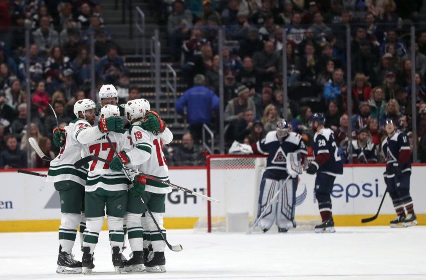 DENVER, COLORADO - DECEMBER 27: Members of the Minnesota Wild celebrate a goal by Brad Hunt #77 against the Colorado Avalanche in the second period at the Pepsi Center on December 27, 2019 in Denver, Colorado. (Photo by Matthew Stockman/Getty Images)
