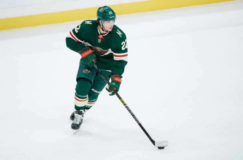 ST PAUL, MINNESOTA - JANUARY 05: Kevin Fiala #22 of the Minnesota Wild controls the puck against the Calgary Flames during the game at Xcel Energy Center on January 5, 2020 in St Paul, Minnesota. The Flames defeated the Wild 5-4 in a shootout. (Photo by Hannah Foslien/Getty Images)
