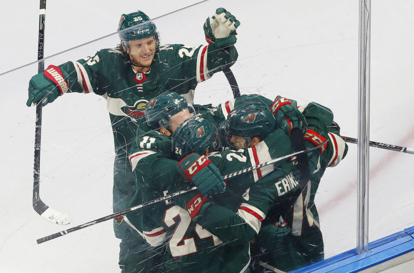 Aug 7, 2020; Edmonton, Alberta, CAN; Minnesota Wild forward Joel Ericsson Ek (14) celebrates with teammates after scoring a goal by against the Vancouver Canucks during the second period in the Western Conference qualifications at Rogers Place. Mandatory Credit: Perry Nelson-USA TODAY Sports