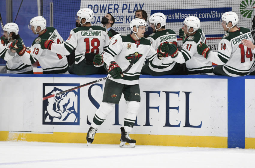 Apr 10, 2021; St. Louis, Missouri, USA; Minnesota Wild center Nico Sturm (7) is congratulated by teammates after scoring a goal against the St. Louis Blues in the first period at Enterprise Center. Mandatory Credit: Jeff Le-USA TODAY Sports