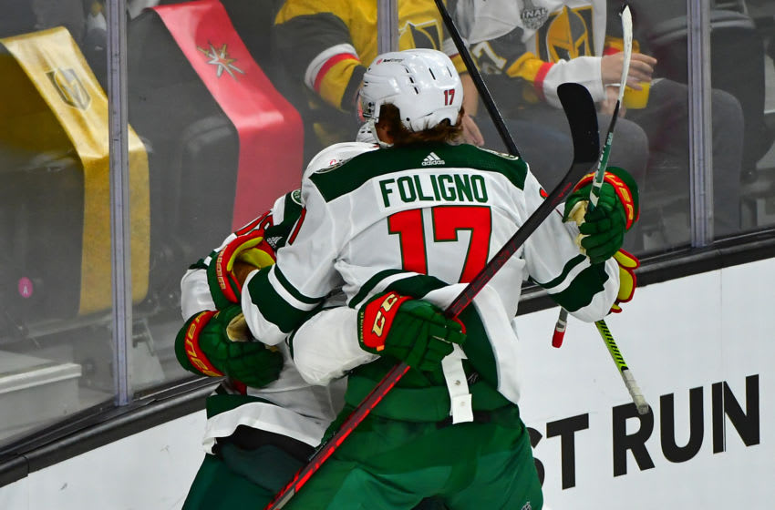May 16, 2021; Las Vegas, Nevada, USA; Minnesota Wild left wing Marcus Foligno (17) celebrates with teammates after Minnesota Wild center Joel Eriksson Ek (14) scores in overtime to give the Wild a 1-0 overtime win over the Vegas Golden Knights in game one of the first round of the 2021 Stanley Cup Playoffs at T-Mobile Arena. Mandatory Credit: Stephen R. Sylvanie-USA TODAY Sports
