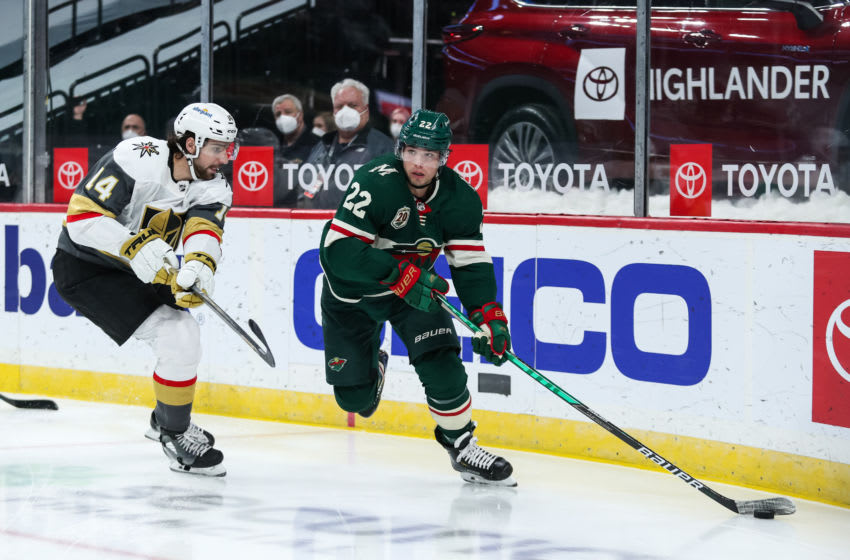 Mar 8, 2021; Saint Paul, Minnesota, USA; Minnesota Wild left wing Kevin Fiala (22) skates with the puck while Vegas Golden Knights defenseman Nicolas Hague (14) defends in the second period at Xcel Energy Center. Mandatory Credit: David Berding-USA TODAY Sports