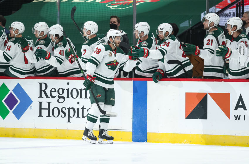 Mar 16, 2021; Saint Paul, Minnesota, USA; Minnesota Wild right wing Ryan Hartman (38) celebrates with teammates after scoring a goal against the Arizona Coyotes in the first period at Xcel Energy Center. Mandatory Credit: David Berding-USA TODAY Sports