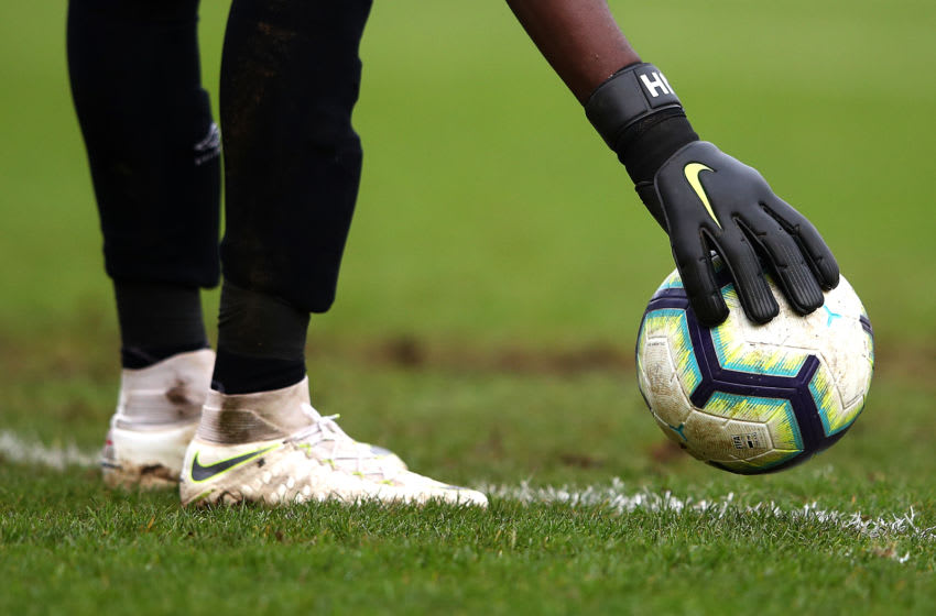 DAGENHAM, ENGLAND - JANUARY 13: Joseph Anang of West Ham places the ball down during the Premier League 2 match between West Ham United and Tottenham Hotspur at Chigwell Construction Stadium on January 13, 2019 in Dagenham, England. (Photo by Alex Pantling/Getty Images)