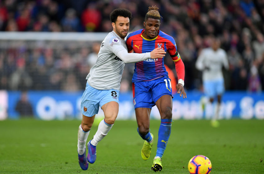 LONDON, ENGLAND - FEBRUARY 09: Felipe Anderson of West Ham United and Wilfried Zaha of Crystal Palace during the Premier League match between Crystal Palace and West Ham United at Selhurst Park on February 9, 2019 in London, United Kingdom. (Photo by Justin Setterfield/Getty Images)