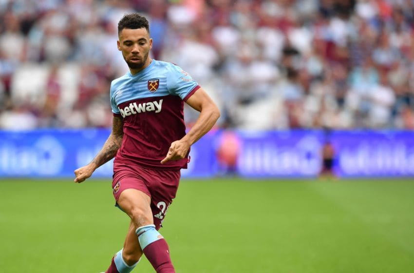 West Ham United's English defender Ryan Fredericks plays the ball during the English Premier League football match between West Ham United and Norwich City at The London Stadium, in east London on August 31, 2019. (Photo by Ben STANSALL / AFP) / RESTRICTED TO EDITORIAL USE. No use with unauthorized audio, video, data, fixture lists, club/league logos or 'live' services. Online in-match use limited to 120 images. An additional 40 images may be used in extra time. No video emulation. Social media in-match use limited to 120 images. An additional 40 images may be used in extra time. No use in betting publications, games or single club/league/player publications. / (Photo credit should read BEN STANSALL/AFP via Getty Images)
