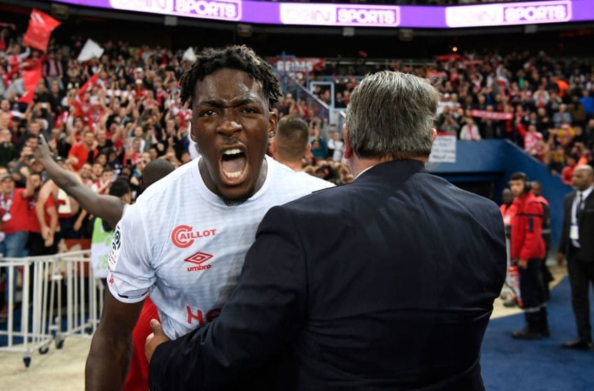 Reims' French defender Axel Disasi celebrates their victory at the end of the French L1 football match between Paris Saint-Germain and Stade de Reims at the Parc des Princes stadium in Paris on September 25, 2019. (Photo by Bertrand GUAY / AFP) (Photo credit should read BERTRAND GUAY/AFP via Getty Images)