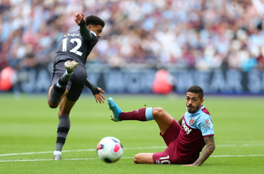 LONDON, ENGLAND - AUGUST 31: Jamal Lewis of Norwich City battles for possession with Manuel Lanzini of West Ham United during the Premier League match between West Ham United and Norwich City at London Stadium on August 31, 2019 in London, United Kingdom. (Photo by Jordan Mansfield/Getty Images)