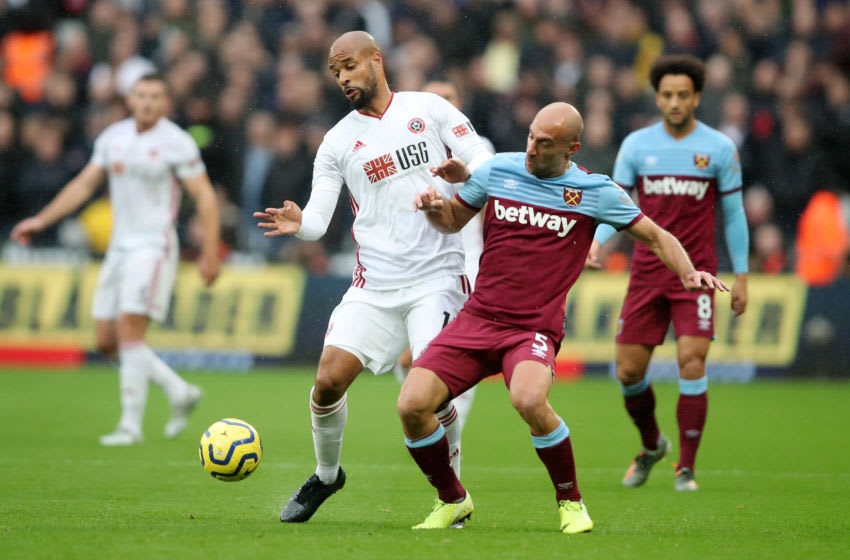 LONDON, ENGLAND - OCTOBER 26: David McGoldrick of Sheffield United battles for possession with Pablo Zabaleta of West Ham United during the Premier League match between West Ham United and Sheffield United at London Stadium on October 26, 2019 in London, United Kingdom. (Photo by Marc Atkins/Getty Images)