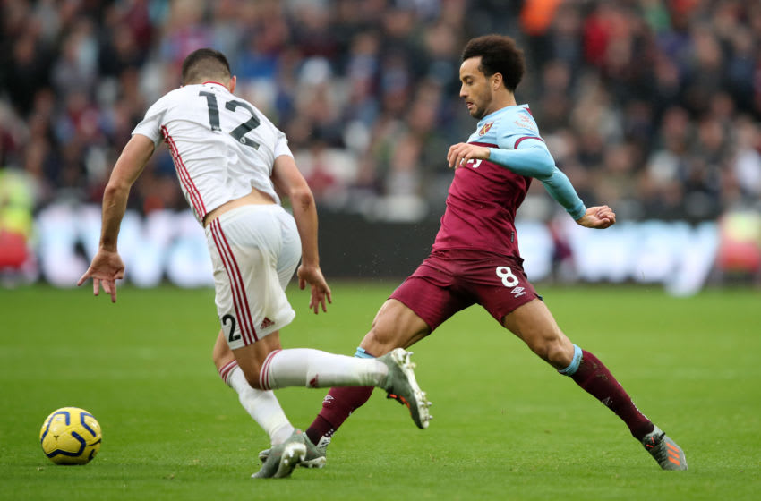 LONDON, ENGLAND - OCTOBER 26: Felipe Anderson of West Ham United is challenged by John Egan of Sheffield United during the Premier League match between West Ham United and Sheffield United at London Stadium on October 26, 2019 in London, United Kingdom. (Photo by Marc Atkins/Getty Images)