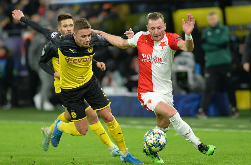 DORTMUND, GERMANY - DECEMBER 10: (BILD ZEITUNG OUT) Thorgan Hazard of Borussia Dortmund and Vladimir Coufal of Slavia Praha battle for the ball during the UEFA Champions League group F match between Borussia Dortmund and Slavia Praha at Signal Iduna Park on December 10, 2019 in Dortmund, Germany. (Photo by TF-Images/Getty Images)