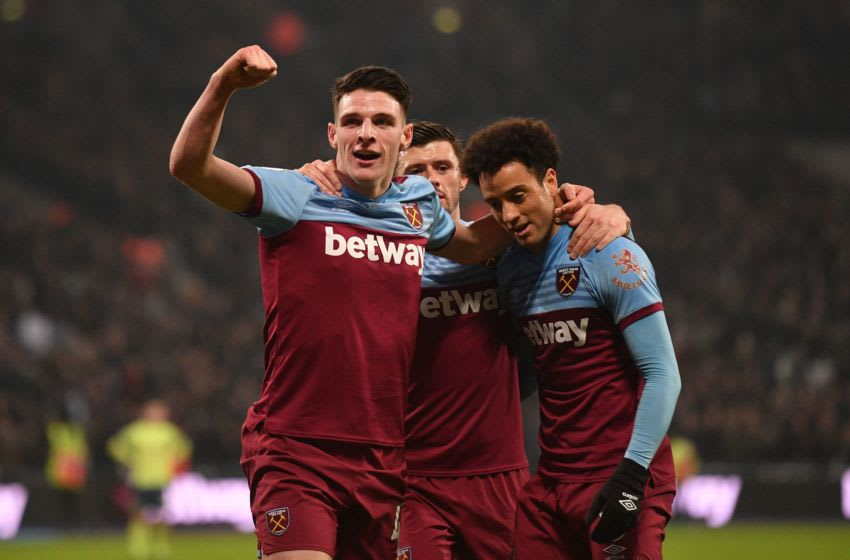 West Ham United's Brazilian midfielder Felipe Anderson (R) celebrates with West Ham United's English midfielder Declan Rice (L) and West Ham United's English defender Aaron Cresswell (C) after scoring their fourth goal during the English Premier League football match between West Ham United and Bournemouth at The London Stadium, in east London on January 1, 2020. (Photo by DANIEL LEAL-OLIVAS / AFP) / RESTRICTED TO EDITORIAL USE. No use with unauthorized audio, video, data, fixture lists, club/league logos or 'live' services. Online in-match use limited to 120 images. An additional 40 images may be used in extra time. No video emulation. Social media in-match use limited to 120 images. An additional 40 images may be used in extra time. No use in betting publications, games or single club/league/player publications. / (Photo by DANIEL LEAL-OLIVAS/AFP via Getty Images)
