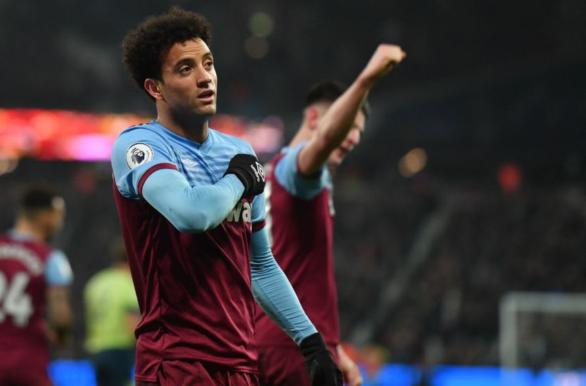 West Ham United's Brazilian midfielder Felipe Anderson celebrates after scoring their fourth goal during the English Premier League football match between West Ham United and Bournemouth at The London Stadium, in east London on January 1, 2020. (Photo by DANIEL LEAL-OLIVAS / AFP) / RESTRICTED TO EDITORIAL USE. No use with unauthorized audio, video, data, fixture lists, club/league logos or 'live' services. Online in-match use limited to 120 images. An additional 40 images may be used in extra time. No video emulation. Social media in-match use limited to 120 images. An additional 40 images may be used in extra time. No use in betting publications, games or single club/league/player publications. / (Photo by DANIEL LEAL-OLIVAS/AFP via Getty Images)