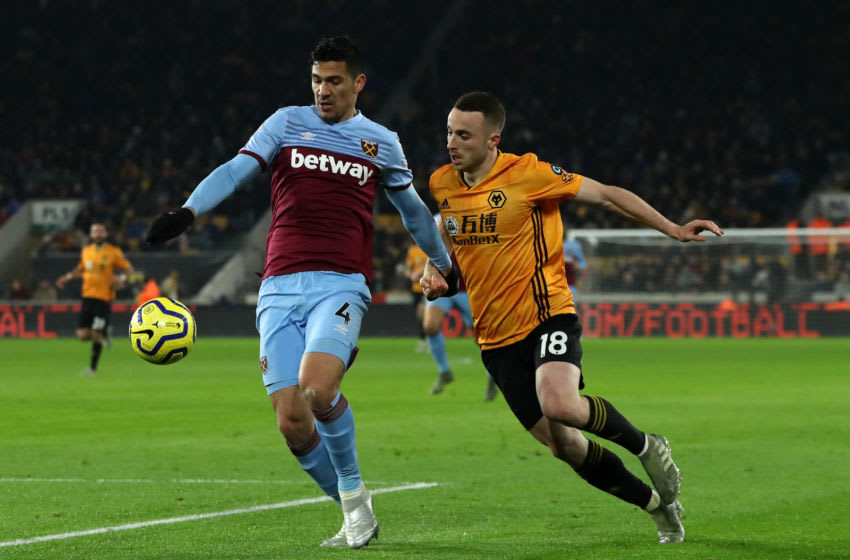 WOLVERHAMPTON, ENGLAND - DECEMBER 04: Diogo Jota of Wolverhampton Wanderers challenges Fabian Balbuena during the Premier League match between Wolverhampton Wanderers and West Ham United at Molineux on December 04, 2019 in Wolverhampton, United Kingdom. (Photo by David Rogers/Getty Images)