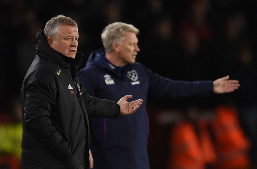 West Ham manager David Moyes and Chris Wilder will go head-to-head on Sunday. (Photo by OLI SCARFF/AFP via Getty Images)