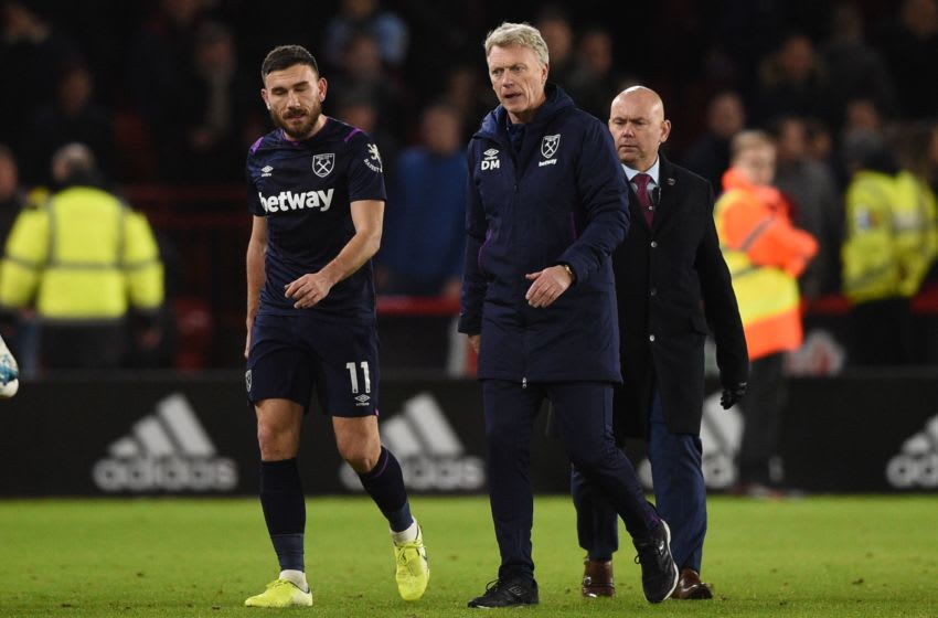 West Ham United's Scottish manager David Moyes (R) reacts at the end of the English Premier League football match between Sheffield United and West Ham United at Bramall Lane in Sheffield, northern England on January 10, 2020. (Photo by Oli SCARFF / AFP) / RESTRICTED TO EDITORIAL USE. No use with unauthorized audio, video, data, fixture lists, club/league logos or 'live' services. Online in-match use limited to 120 images. An additional 40 images may be used in extra time. No video emulation. Social media in-match use limited to 120 images. An additional 40 images may be used in extra time. No use in betting publications, games or single club/league/player publications. / (Photo by OLI SCARFF/AFP via Getty Images)