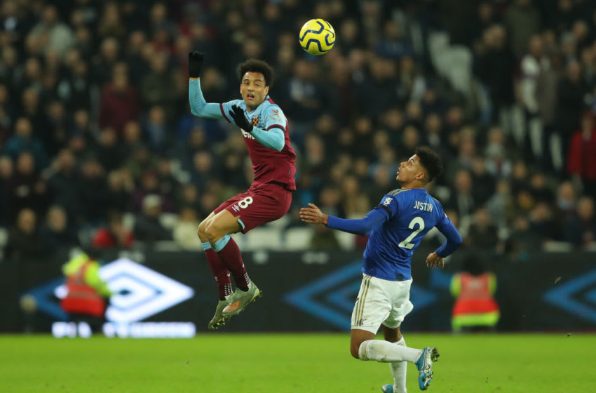 LONDON, ENGLAND - DECEMBER 28: Felipe Anderson of West Ham United jumps for a header infront of James Justin of Leicester City during the Premier League match between West Ham United and Leicester City at London Stadium on December 28, 2019 in London, United Kingdom. (Photo by Warren Little/Getty Images)