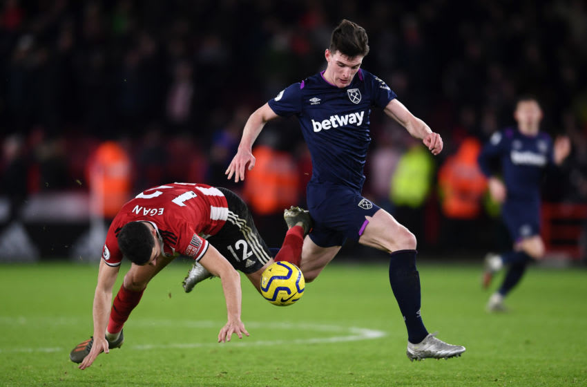 SHEFFIELD, ENGLAND - JANUARY 10: John Egan of Sheffield United battles for possession with Declan Rice of West Ham United during the Premier League match between Sheffield United and West Ham United at Bramall Lane on January 10, 2020 in Sheffield, United Kingdom. (Photo by Laurence Griffiths/Getty Images)