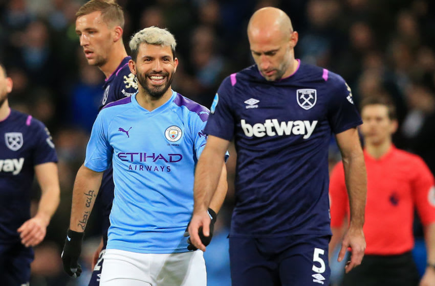 Manchester City's Argentinian striker Sergio Aguero (L) smiles as West Ham United's Argentinian defender Pablo Zabaleta walks away during the English Premier League football match between Manchester City and West Ham United at the Etihad Stadium in Manchester, north west England, on February 19, 2020. (Photo by Lindsey Parnaby / AFP) / RESTRICTED TO EDITORIAL USE. No use with unauthorized audio, video, data, fixture lists, club/league logos or 'live' services. Online in-match use limited to 120 images. An additional 40 images may be used in extra time. No video emulation. Social media in-match use limited to 120 images. An additional 40 images may be used in extra time. No use in betting publications, games or single club/league/player publications. / (Photo by LINDSEY PARNABY/AFP via Getty Images)