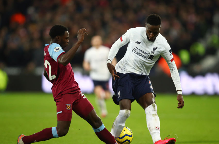 LONDON, ENGLAND - JANUARY 29: Divock Origi of Liverpool is tackled by Jeremy Ngakia of West Ham United during the Premier League match between West Ham United and Liverpool FC at London Stadium on January 29, 2020 in London, United Kingdom. (Photo by Julian Finney/Getty Images)