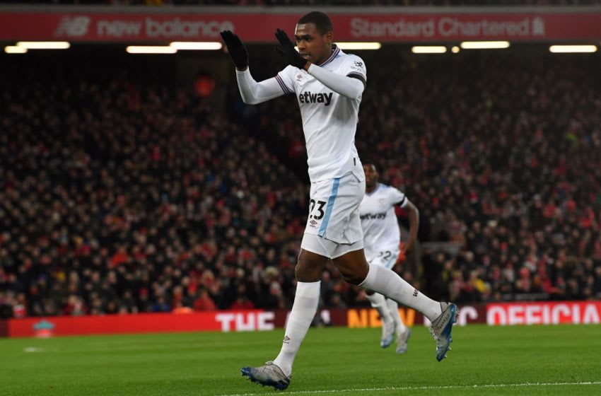 West Ham United's French defender Issa Diop celebrates after scoring the equalising goal during the English Premier League football match between Liverpool and West Ham United at Anfield in Liverpool, north west England on February 24, 2020. (Photo by Paul ELLIS / AFP) / RESTRICTED TO EDITORIAL USE. No use with unauthorized audio, video, data, fixture lists, club/league logos or 'live' services. Online in-match use limited to 120 images. An additional 40 images may be used in extra time. No video emulation. Social media in-match use limited to 120 images. An additional 40 images may be used in extra time. No use in betting publications, games or single club/league/player publications. / (Photo by PAUL ELLIS/AFP via Getty Images)