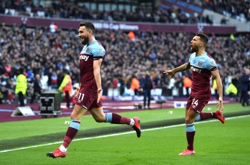 LONDON, ENGLAND - FEBRUARY 01: Robert Snodgrass of West Ham United celebrates with Ryan Fredericks after scoring his team's second goal during the Premier League match between West Ham United and Brighton & Hove Albion at London Stadium on February 01, 2020 in London, United Kingdom. (Photo by Mike Hewitt/Getty Images)