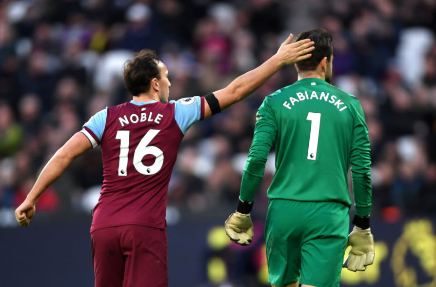 LONDON, ENGLAND - FEBRUARY 01: Mark Noble of West Ham United pats Lukasz Fabianski of West Ham United on the head during the Premier League match between West Ham United and Brighton & Hove Albion at London Stadium on February 01, 2020 in London, United Kingdom. (Photo by Mike Hewitt/Getty Images)