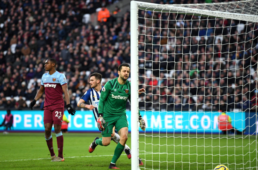 LONDON, ENGLAND - FEBRUARY 01: Pascal Gross of Brighton and Hove Albion celebrates after scoring his team's second goal as Lukasz Fabianski of West Ham United reacts during the Premier League match between West Ham United and Brighton & Hove Albion at London Stadium on February 01, 2020 in London, United Kingdom. (Photo by Mike Hewitt/Getty Images)