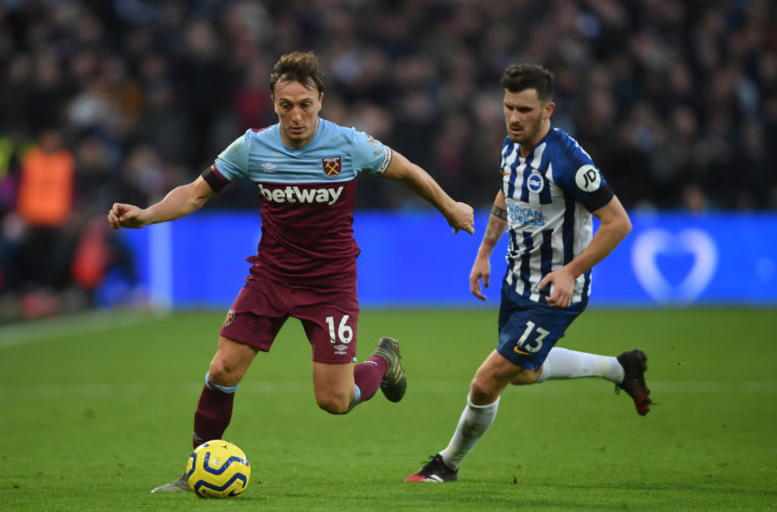 LONDON, ENGLAND - FEBRUARY 01: Mark Noble of West Ham United gets past Pascal Gross of Brighton & Hove Albion during the Premier League match between West Ham United and Brighton & Hove Albion at London Stadium on February 01, 2020 in London, United Kingdom. (Photo by Mike Hewitt/Getty Images)