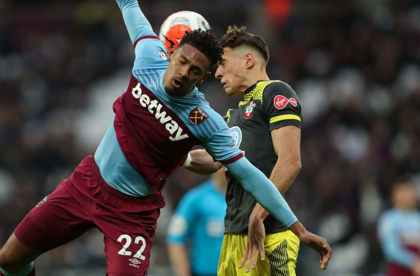 LONDON, ENGLAND - FEBRUARY 29: Sebastien Haller of West Ham United and Jan Bednarek of Southampton during the Premier League match between West Ham United and Southampton FC at London Stadium on February 29, 2020 in London, United Kingdom. (Photo by James Williamson - AMA/Getty Images)