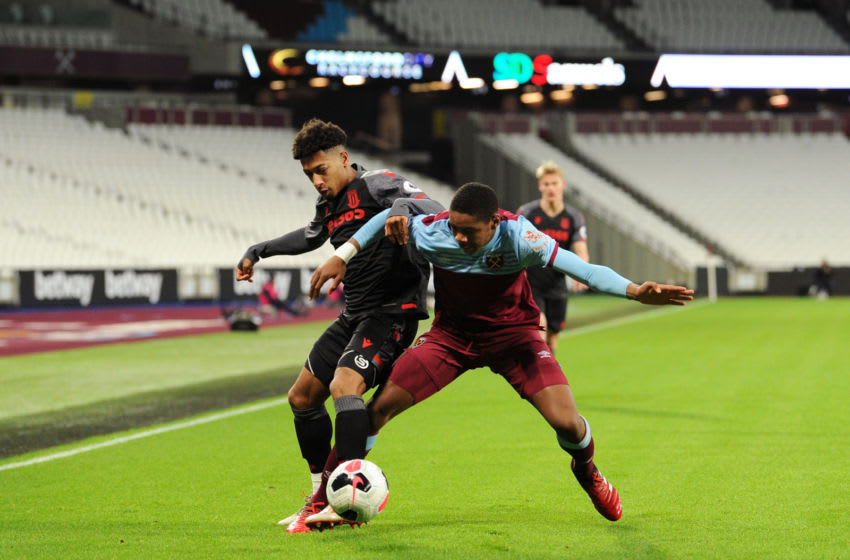 LONDON, ENGLAND - FEBRUARY 17: Tre Pemberton of Stoke City battles for possession with Jamal Baptiste of West Ham United during the Premier League 2 match between West Ham United U23 and Stoke City U23 at London Stadium on February 17, 2020 in London, England. (Photo by Alex Burstow/Getty Images)