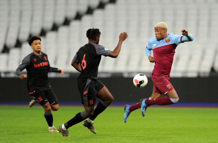 LONDON, ENGLAND - FEBRUARY 17: Xande Silva of West Ham United attempts to control the ball under pressure from Ash Kigbu and Tre Pemberton of Stoke City during the Premier League 2 match between West Ham United U23 and Stoke City U23 at London Stadium on February 17, 2020 in London, England. (Photo by Alex Burstow/Getty Images)