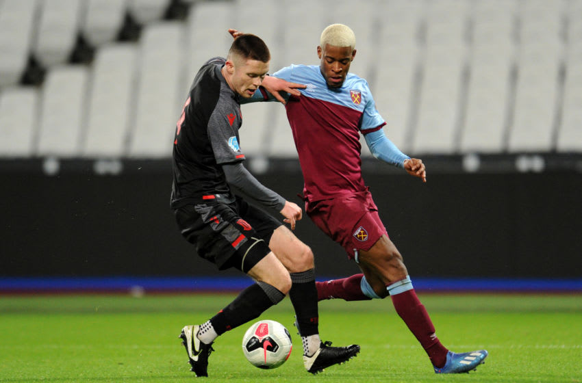 LONDON, ENGLAND - FEBRUARY 17: Xande Silva of West Ham United battles for possession with William Forrester of Stoke City during the Premier League 2 match between West Ham United U23 and Stoke City U23 at London Stadium on February 17, 2020 in London, England. (Photo by Alex Burstow/Getty Images)