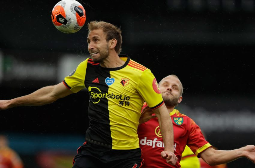 Watford's English defender Craig Dawson (L) vies for the ball with Norwich City's Finnish striker Teemu Pukki during the English Premier League football match between Watford and Norwich City at Vicarage Road Stadium in Watford, north of London, on July 7, 2020. (Photo by Matt Dunham / POOL / AFP) / RESTRICTED TO EDITORIAL USE. No use with unauthorized audio, video, data, fixture lists, club/league logos or 'live' services. Online in-match use limited to 120 images. An additional 40 images may be used in extra time. No video emulation. Social media in-match use limited to 120 images. An additional 40 images may be used in extra time. No use in betting publications, games or single club/league/player publications. / (Photo by MATT DUNHAM/POOL/AFP via Getty Images)