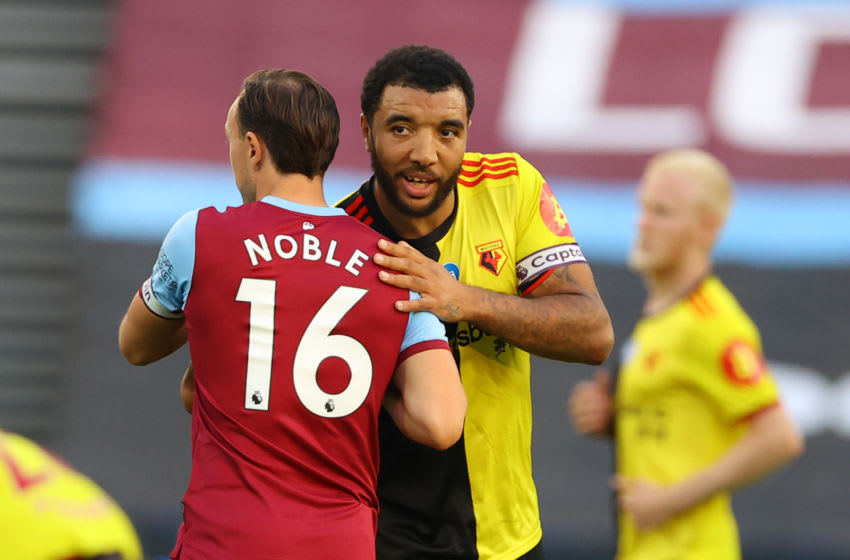 West Ham United's English midfielder Mark Noble (L) and Watford's English striker Troy Deeney (R) embrace ahead of the English Premier League football match between West Ham United and Watford at The London Stadium, in east London on July 17, 2020. (Photo by Richard Heathcote / POOL / AFP) / RESTRICTED TO EDITORIAL USE. No use with unauthorized audio, video, data, fixture lists, club/league logos or 'live' services. Online in-match use limited to 120 images. An additional 40 images may be used in extra time. No video emulation. Social media in-match use limited to 120 images. An additional 40 images may be used in extra time. No use in betting publications, games or single club/league/player publications. / (Photo by RICHARD HEATHCOTE/POOL/AFP via Getty Images)