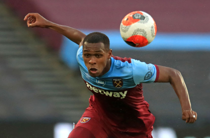 West Ham United's French defender Issa Diop heads the ball during the English Premier League football match between West Ham United and Watford at The London Stadium, in east London on July 17, 2020. (Photo by Adam Davy / POOL / AFP) / RESTRICTED TO EDITORIAL USE. No use with unauthorized audio, video, data, fixture lists, club/league logos or 'live' services. Online in-match use limited to 120 images. An additional 40 images may be used in extra time. No video emulation. Social media in-match use limited to 120 images. An additional 40 images may be used in extra time. No use in betting publications, games or single club/league/player publications. / (Photo by ADAM DAVY/POOL/AFP via Getty Images)