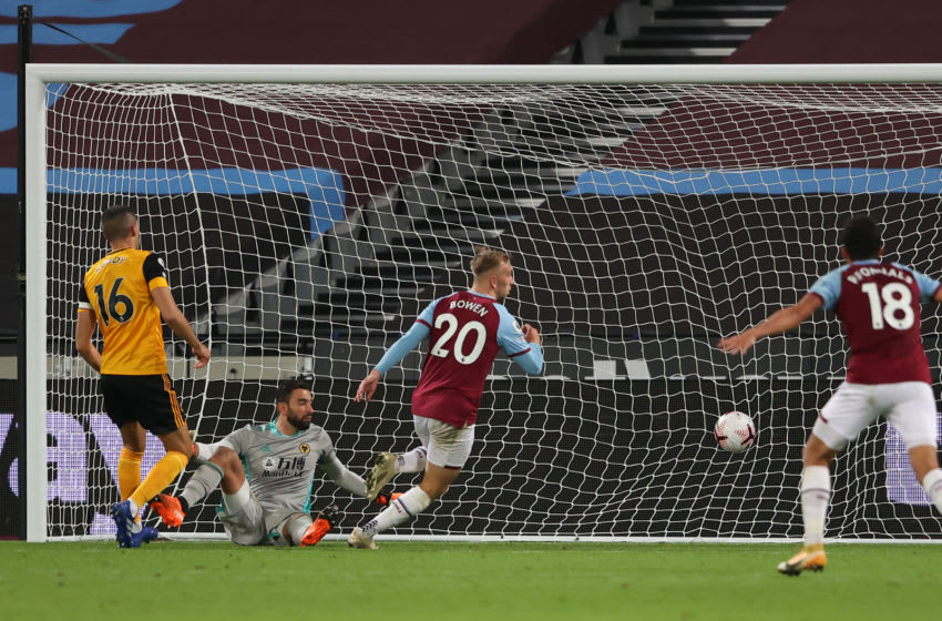 LONDON, ENGLAND - SEPTEMBER 27: Jarrod Bowen of West Ham United scores a goal to make it 2-0 during the Premier League match between West Ham United and Wolverhampton Wanderers at London Stadium on September 27, 2020 in London, United Kingdom. Sporting stadiums around the UK remain under strict restrictions due to the Coronavirus Pandemic as Government social distancing laws prohibit fans inside venues resulting in games being played behind closed doors. (Photo by Matthew Ashton - AMA/Getty Images)